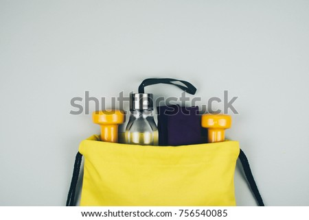 Creative flat lay of sport and fitness equipments with copy space.