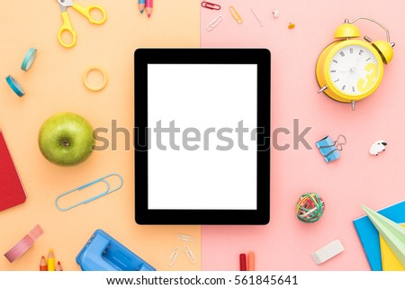 Creative flat lay photo with tablet. Back to school concept. Office workspace. Top view with copy space.