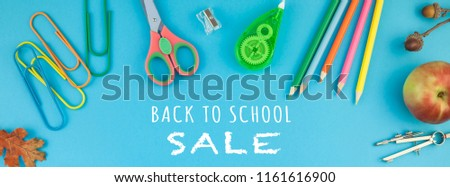 Creative flat lay top view back to school concept with color school and office supplies on bright turquoise paper table frame background with copy space, template for text or design. Long wide banner #1161616900