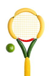 Creative food healthy eating concept photo of sport tennis racket made of fruits vegetables and noodle net with a lime as a ball on white background.