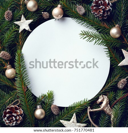 Creative frame of Christmas tree branches and decorations with round blank card. Top view. Xmas and New year concept #751770481
