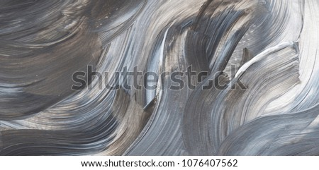 Creative grey abstract hand painted background, wallpaper, texture, close-up fragment of acrylic painting on canvas with brush strokes. Modern art. Contemporary art.