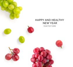 Creative happy and healthy new year card made of grapes on the white background.  Grapes happy new year, top view, festive greeting card.