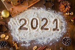 Creative Happy New Year 2021 greeting card for home baker, baking, numbers made out of flour, top view