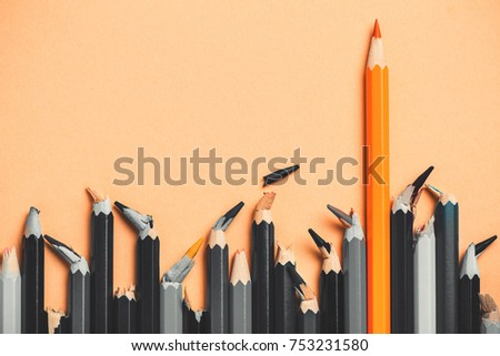 creative idea, concept of leadership, competition in business, leader among people with broken core, losers; success in comparison with defeat, colored pencil among black and white