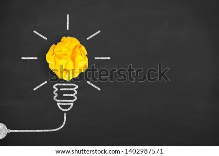 Creative Idea Concepts Light Bulb with Crumpled Paper on Blackboard Background