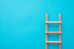Creative idea, imagination, design and invention concept. Flat lay minimal style of staircase pencils on blue pastel background with copy space. Outstanding idea is attractive.