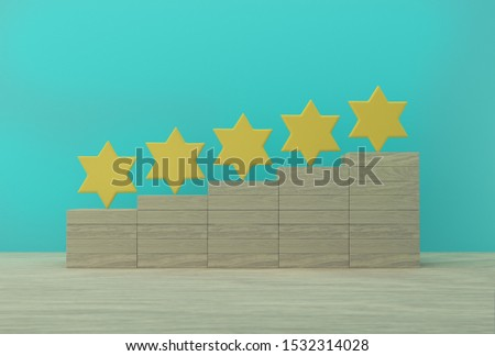 Creative idea of yellow five star shape on box wooden. The best excellent business services rating for satisfaction.