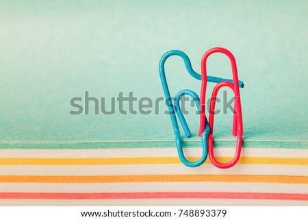 creative idea, the concept of happy relationships in the family, clips in the form of a hugging couple in love