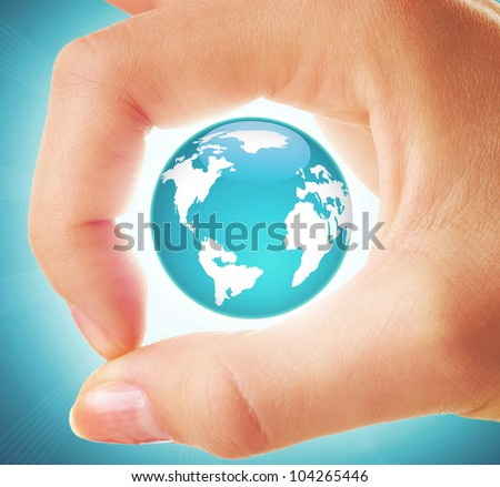 Creative image of earth model inside circle made up of human thumb and forefinger