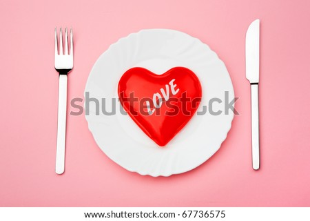 Creative image of valentine heart served on plate with fork and knife near by