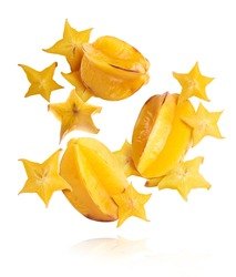 Creative image with fresh ripe yellow carambola or starfruit falling in the air isolated on the white background. Food levitation or zero gravity conception. High resolution image