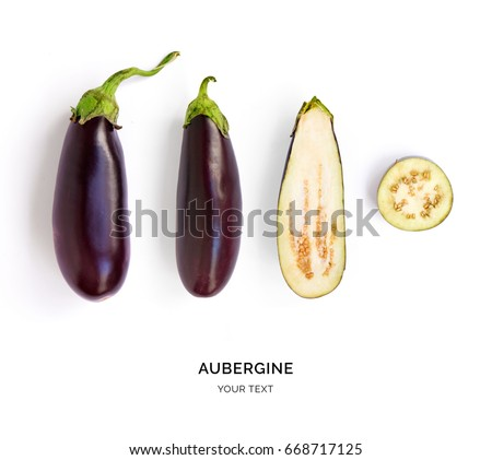 Creative layout made of aubergine. Flat lay. Food concept. Vegetables isolated on white background.