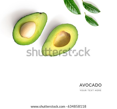 Creative layout made of avocado and leaves. Flat lay. Food concept. Avocado on white background.