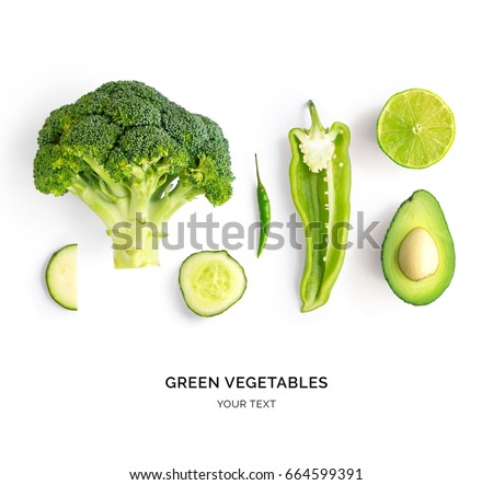 Creative layout made of avocado, lime, broccoli, green pepper, cucumber, chilli pepper and zucchini. Flat lay. Food concept. Green vegetables isolated on white background. #664599391