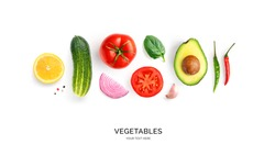 Creative layout made of avocado, onion, tomatoes, chilly pepper, cucumber, garlic and lemon. Flat lay. Food concept. Vegetables isolated on white background.