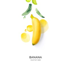 Creative layout made of banana with watercolor spots on the white background. Flat lay. Food concept.