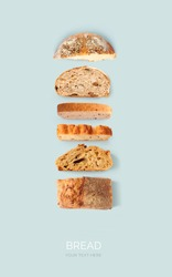 Creative layout made of bread on the blue background. Flat lay. Food concept.