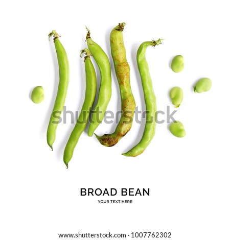 Creative layout made of broad beans on white background. Flat lay. Food concept.