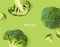 Creative layout made of Broccoli. Flat lay. Food concept. Broccoli on the green background.