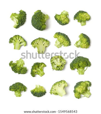 Creative layout made of broccoli. Flat lay, top view. Vegetables isolated over white background. Food ingredient pattern.