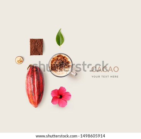Creative layout made of cacao, cacao beans, candy, flower and cacao drink on light background. Flat lay. Food concept. Macro  concept.