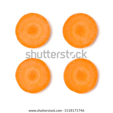 Creative layout made of carrot slices. Flat lay, top view. Vegetables isolated on white background. Food ingredient pattern..