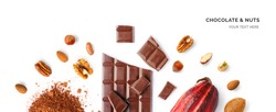 Creative layout made of chocolate, walnut, hazelnut, almonds, cacao fruit and cacao powder on the white background. Flat lay. Food concept.