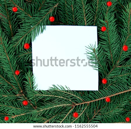 Creative layout made of Christmas tree branches with paper card note. Flat lay. Nature New Year concept. #1162555504