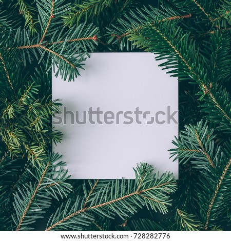 Creative layout made of Christmas tree branches with paper card note. Flat lay. Nature New Year concept. #728282776