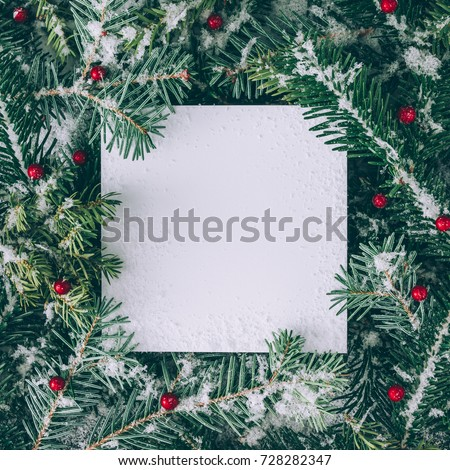 Creative layout made of Christmas tree branches with snow and paper card note. Flat lay. Nature New Year concept. #728282347