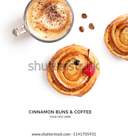 Creative layout made of cinnamon buns and cup of coffee. Flat lay. Food concept.
