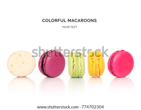 Creative layout made of colorful macaroons on the white background. Flat lay. Food concept.
