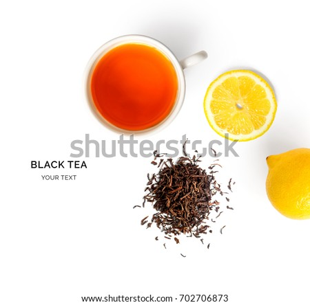 Creative layout made of cup of black tea and lemon on a white background. Top view. #702706873