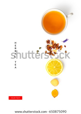 Creative layout made of cup of herbal tea, lemon, ginger on a white background. Top view #650875090