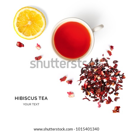 Creative layout made of cup of hibiscus tea and lemon on a white background. Top view.