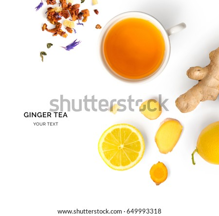 Creative layout made of cup of hot tea with ginger and lemon on a white background. Top view