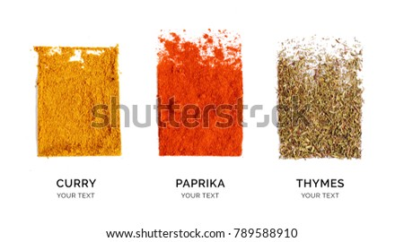 Creative layout made of curry, paprika and thyme. Flat lay. Food concept. Thyme, paprika and curry powder on the white background. #789588910
