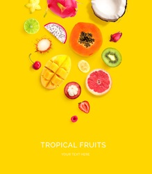 Creative layout made of dragonfruit, papaya, coconut, cherry, kiwi, strawberry, mango, mangosteen, carambola, rambutan, banana on the yellow background. Flat lay. Food concept.