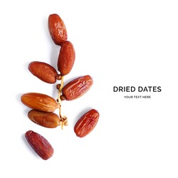 Creative layout made of dried dates on the white background. Flat lay. Food concept.