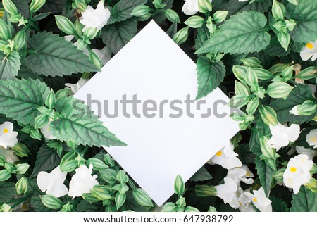 Creative layout made of flowers and leaves with paper card note. - Shutterstock ID 647938792
