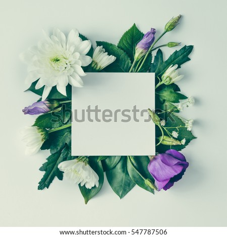 Creative layout made of flowers and leaves with paper card note. Flat lay. Nature concept #547787506