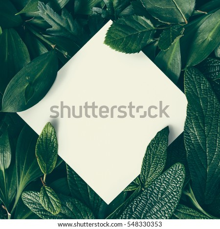 Creative layout made of flowers and leaves with paper card note. Flat lay. Nature concept - Shutterstock ID 548330353