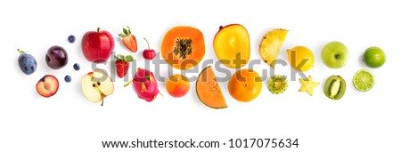 Creative layout made of fruits. Flat lay. Plum, apple, strawberry, blueberry, papaya, pineapple, lemon, orange, lime, kiwi, melon, apricot, pitaya and carambola on the white background. #1017075634