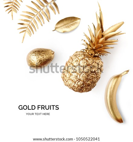 Creative layout made of gold pineapple, gold avocado, gold banana.  Tropical flat lay. Food concept.