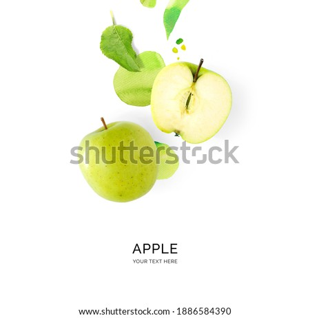 Creative layout made of green apple with watercolor spots on the white background. Flat lay. Food concept.
