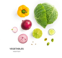 Creative layout made of green cabbage, onion, yellow pepper and lime. Flat lay. Food concept. Vegetables isolated on white background.