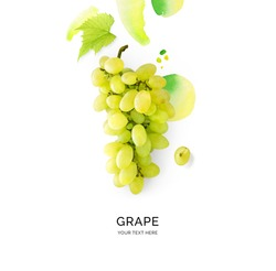 Creative layout made of green grape on the watercolor background. Flat lay. Food concept.