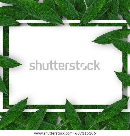 Creative layout made of green leaves with paper card note. Flat lay. Nature concept #687115186