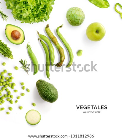 Creative layout made of green vegetables and fruits. Flat lay. Food concept. Avocado, \ broad bean, green peas, green apple, cherimoya, rosemary, zucchini and green lettuce on the white background.